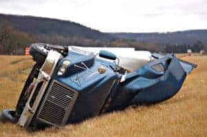 tractor trailer rolls over and lands in the median