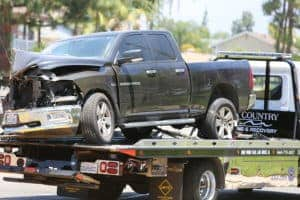 Flat Bed Tow Truck With A Pickup Truck On It