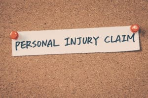 Personal injury claim note pinned on the bulletin board