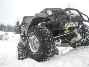off-road truck stuck at snow